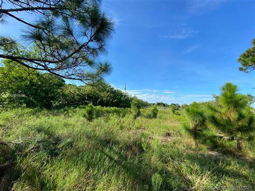 Photo of 1421 SW Becker Rd, Port Saint Lucie, FL 34953 (MLS # A10988209)