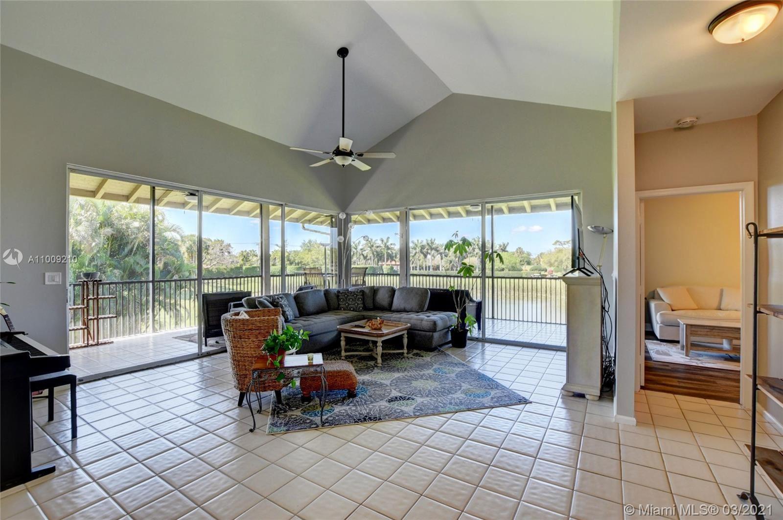 Photo of 7640 Elmridge Dr #13-U, Boca Raton, FL 33433 (MLS # A11009210)