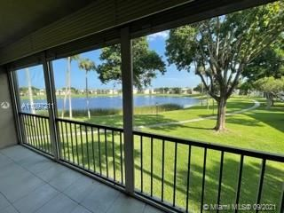 Photo of 5220 Las Verdes Cir #207, Delray Beach, FL 33484 (MLS # A11097211)