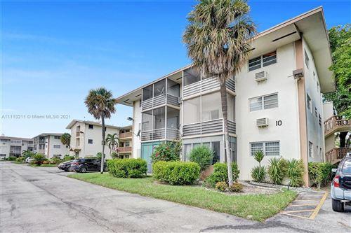 Photo of 1395 NE 167th St #211, Miami, FL 33162 (MLS # A11113211)