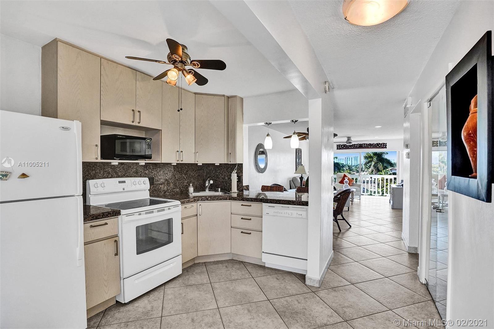 Photo of 455 Paradise Isle Blvd #409, Hallandale Beach, FL 33009 (MLS # A11005211)