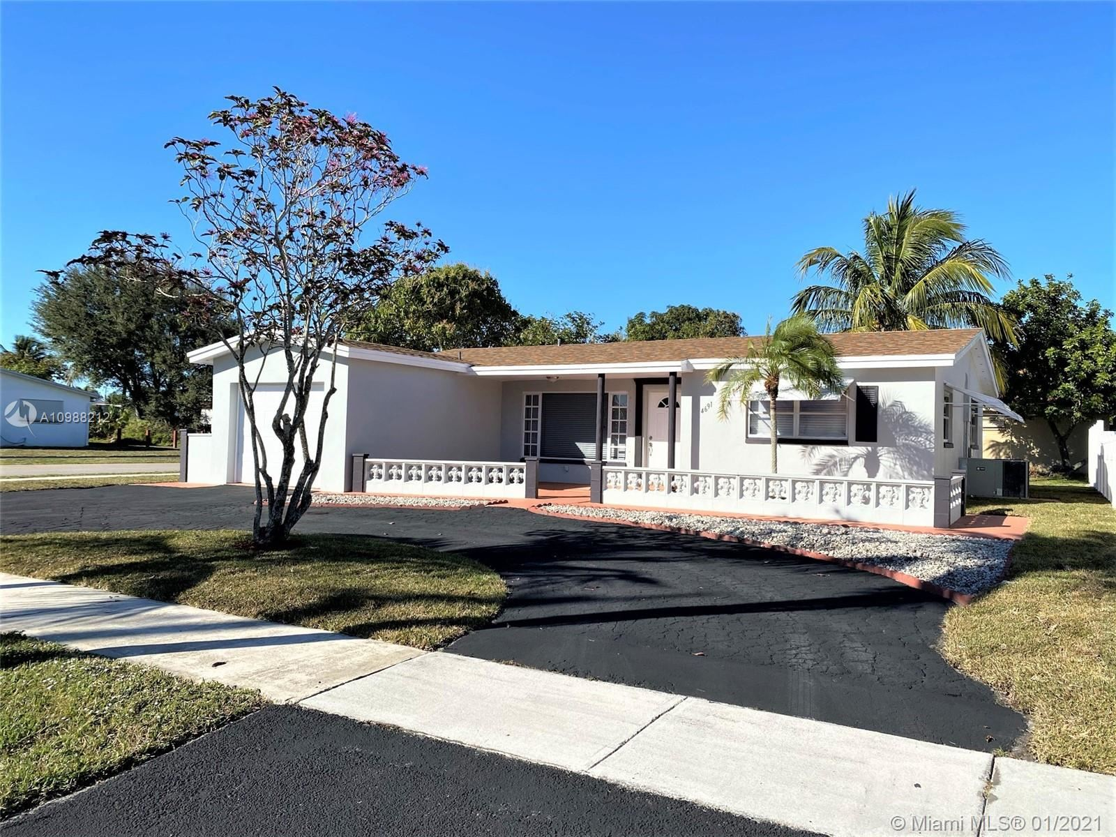 Photo of 4691 NW 41st St, Lauderdale Lakes, FL 33319 (MLS # A10988212)