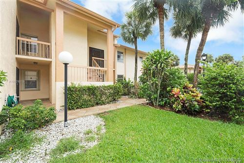 Photo of 5630 Spindle Palm #D, Delray Beach, FL 33484 (MLS # A10929215)