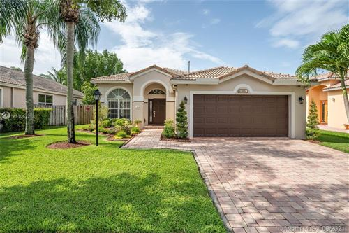 Photo of 13182 NW 18th Ct, Pembroke Pines, FL 33028 (MLS # A11053218)