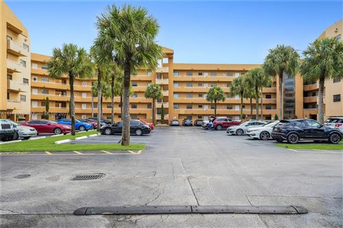 Photo of 15969 NW 64th Ave #307, Miami Lakes, FL 33014 (MLS # A11116218)
