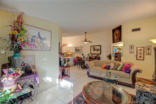 Photo of 4640 NW 102nd Ave #20216, Doral, FL 33178 (MLS # A10984221)