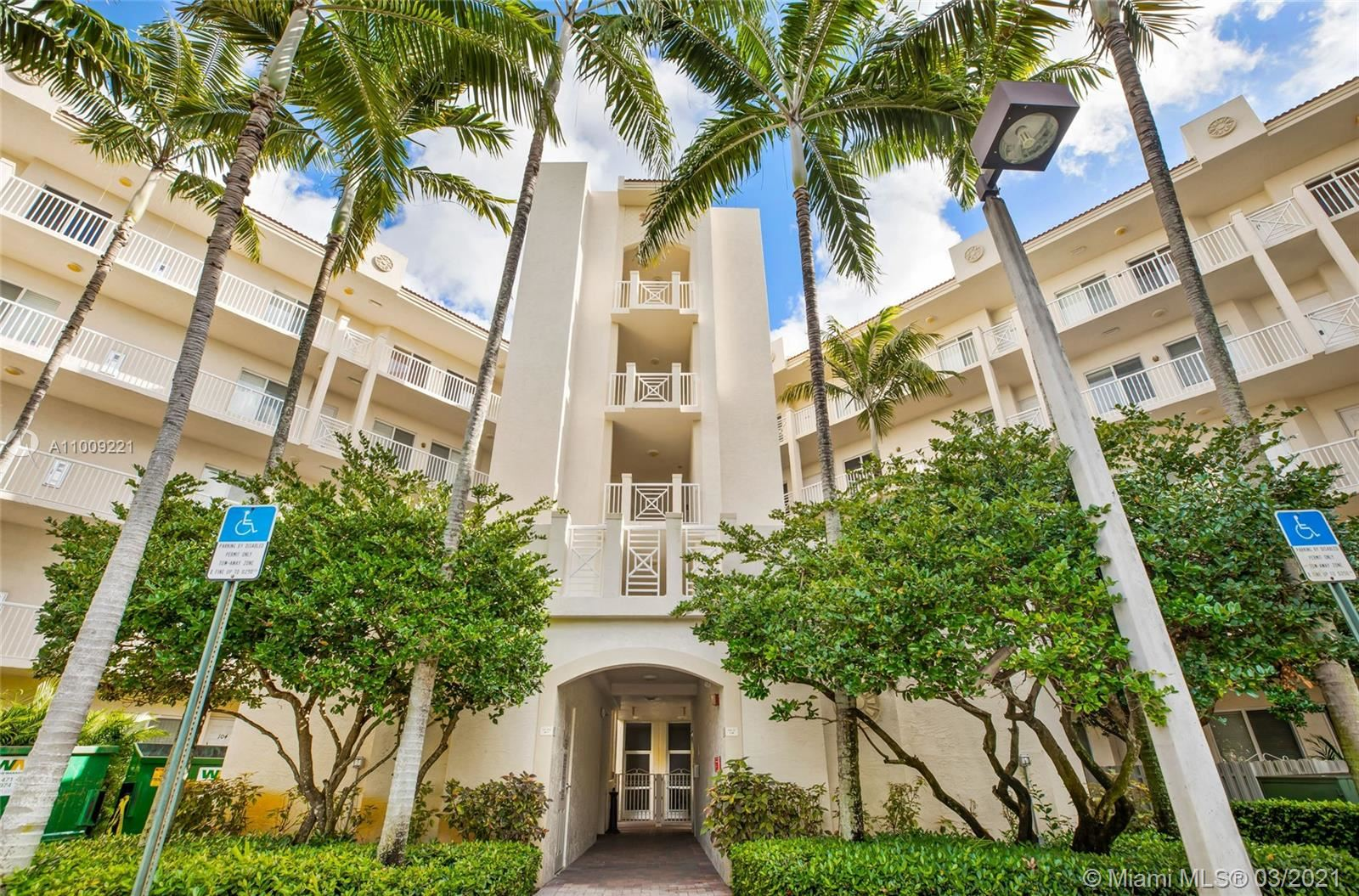 Photo of 3600 Oaks Clubhouse Dr #305, Pompano Beach, FL 33069 (MLS # A11009221)