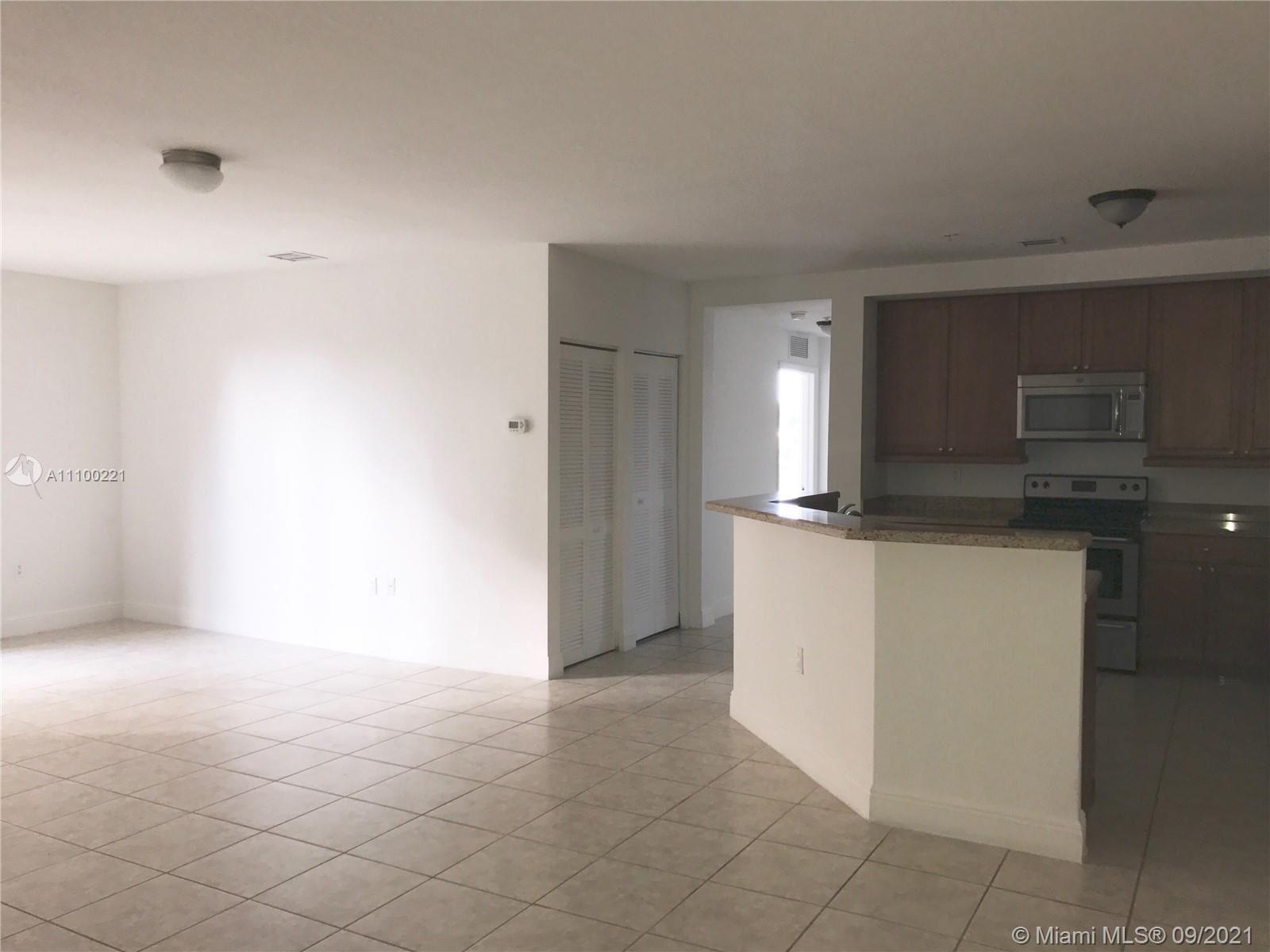 Photo of 107 Mendoza Ave #205, Coral Gables, FL 33134 (MLS # A11100221)