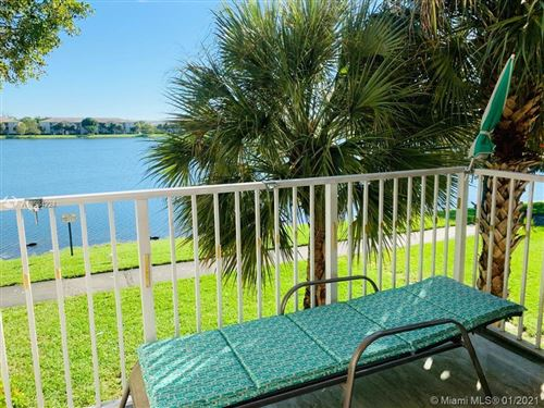 Photo of 5015 Wiles Rd #206, Coconut Creek, FL 33073 (MLS # A10984224)