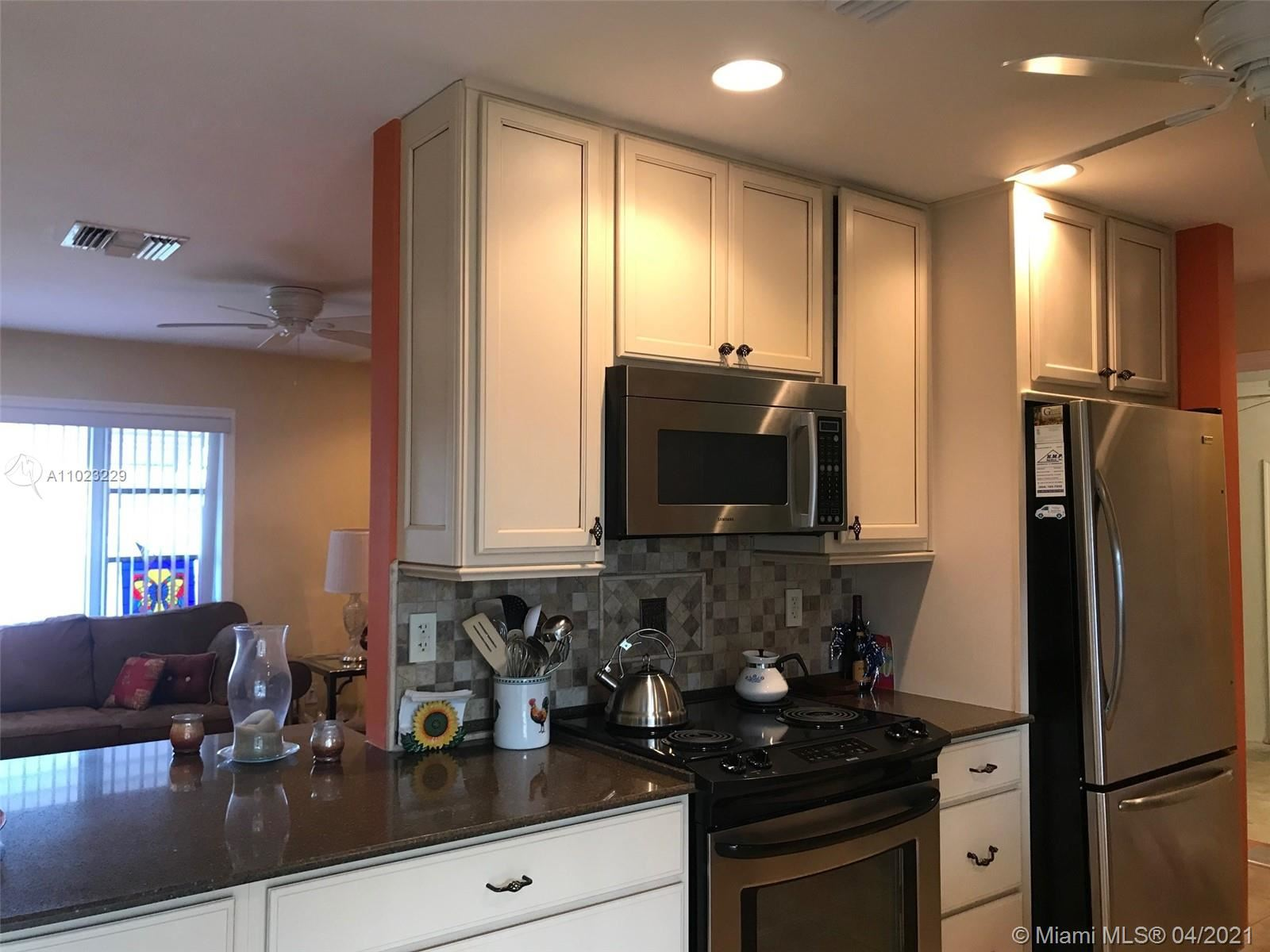 Photo of 1611 NW 86th Ter, Plantation, FL 33322 (MLS # A11023229)