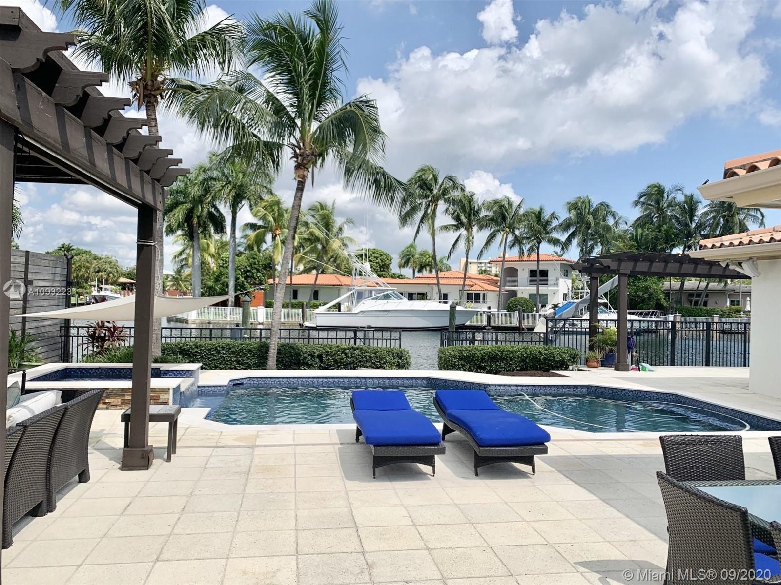 Photo of 2085 Ixora Rd, North Miami, FL 33181 (MLS # A10932231)