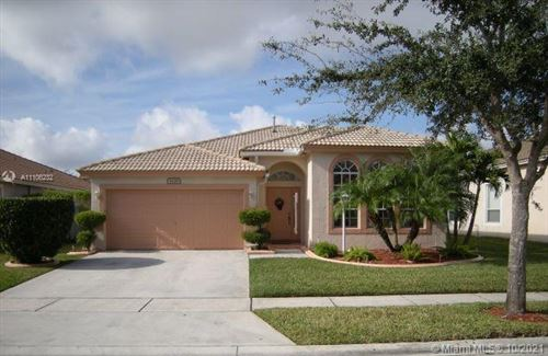 Photo of 1628 NW 143rd Ter, Pembroke Pines, FL 33028 (MLS # A11106232)