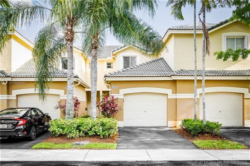 Photo of 2064 Hacienda Ter #2064, Weston, FL 33327 (MLS # A11040234)