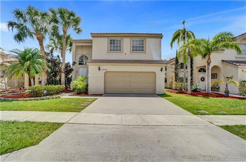 Photo of 1240 NW 159th Ave, Pembroke Pines, FL 33028 (MLS # A11051234)