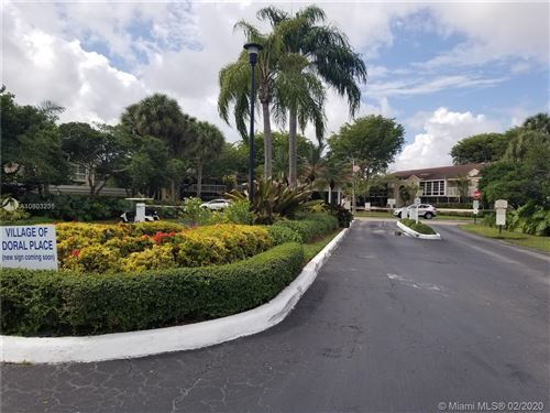 Photo of 4760 NW 102nd Ave #207-12, Doral, FL 33178 (MLS # A10803235)