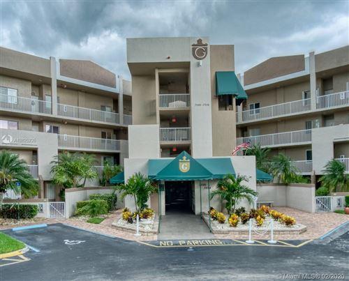 Photo of 7594 Granville Dr #412, Tamarac, FL 33321 (MLS # A10825235)