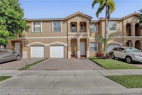 Photo of 13565 NW 7th St #13565, Pembroke Pines, FL 33028 (MLS # A11109238)