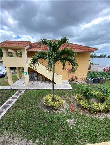 Photo of 8390 NW 103rd St #203H, Hialeah Gardens, FL 33016 (MLS # A10773242)