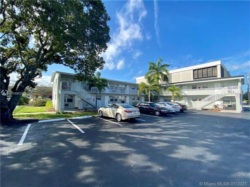 Photo of 616 Lucerne Ave #5, Lake Worth, FL 33460 (MLS # A10986242)