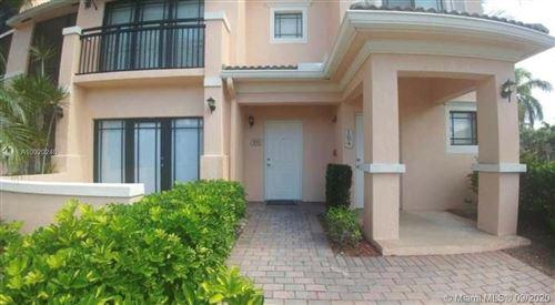 Photo of 2809 Amalei Dr #103, Palm Beach Gardens, FL 33410 (MLS # A10920246)