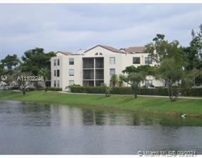 Photo of 216 Lake Pointe Dr #223, Oakland Park, FL 33309 (MLS # A11102246)