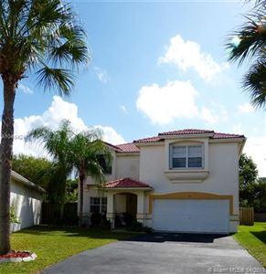 Photo of 94 Gables Blvd, Weston, FL 33326 (MLS # A10454247)