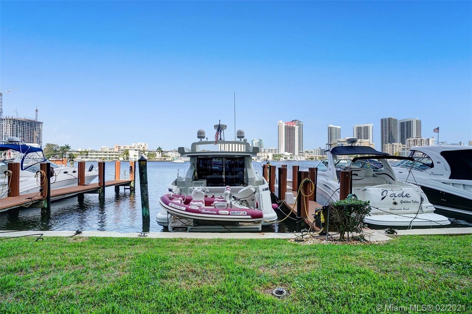 Photo of 410 Golden Isles Dr #106, Hallandale Beach, FL 33009 (MLS # A10997247)