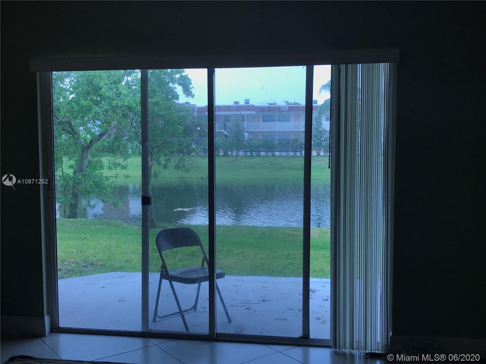 Photo of 6984 SW 39th St #H102, Davie, FL 33314 (MLS # A10871252)