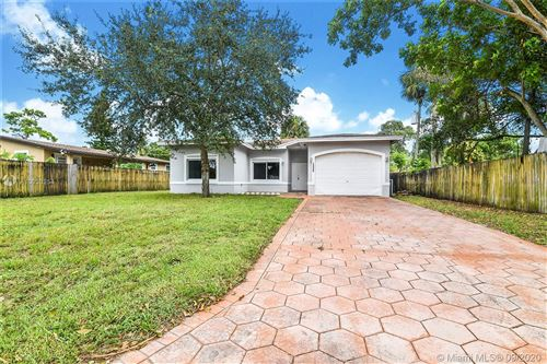 Photo of 1335 SW 26th Ave, Fort Lauderdale, FL 33312 (MLS # A10933254)
