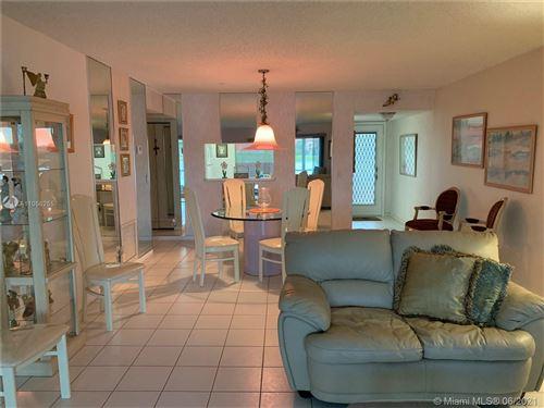 Photo of 13101 SW 11th Ct #106B, Pembroke Pines, FL 33027 (MLS # A11056255)