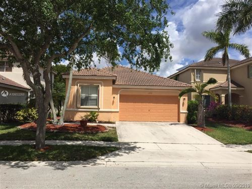 Photo of 1731 Winterberry Ln, Weston, FL 33327 (MLS # A10653260)