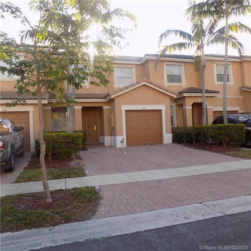 Photo of 975 NE 41PL #975, Homestead, FL 33033 (MLS # A10840262)