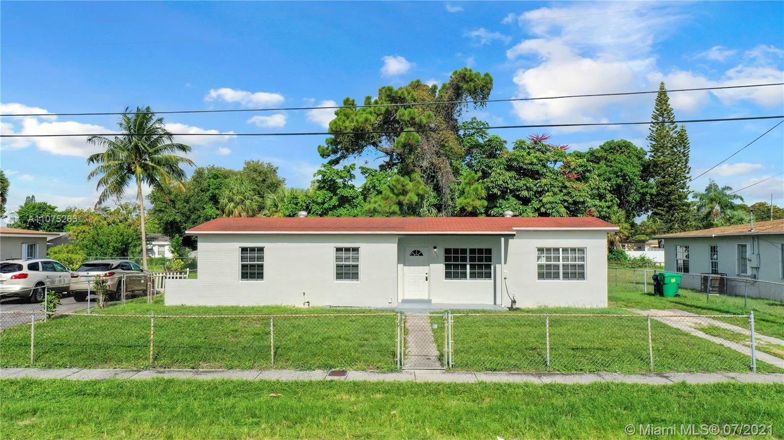 Photo of 611 NW 34th Ter, Lauderhill, FL 33311 (MLS # A11075263)