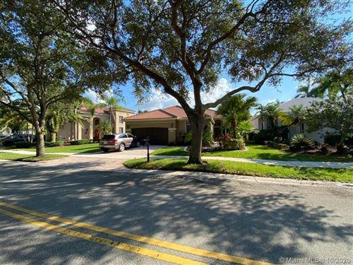 Photo of 1216 Camellia Cir, Weston, FL 33326 (MLS # A10942265)