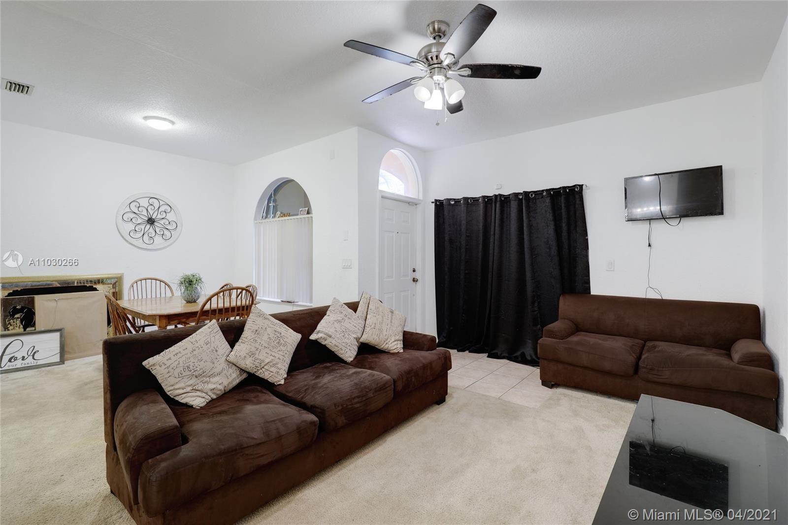 Photo of 1313 N Santa Catalina Cir, North Lauderdale, FL 33068 (MLS # A11030266)