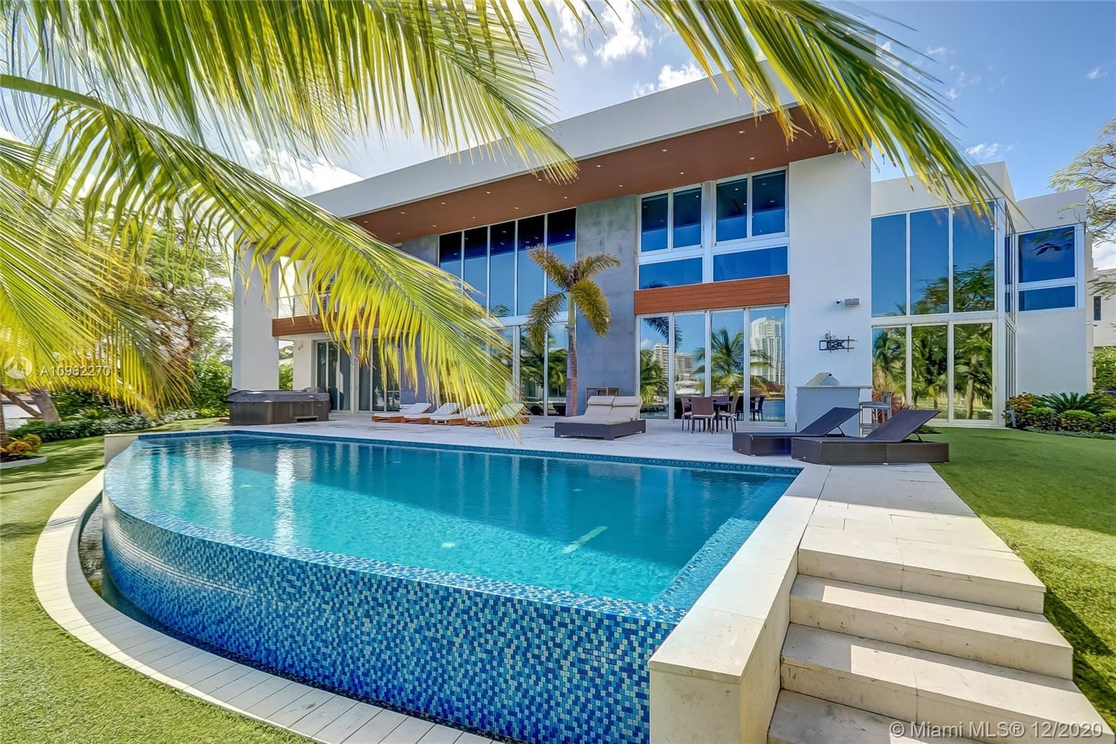 Photo of 400 Tamarind Dr, Hallandale Beach, FL 33009 (MLS # A10962270)