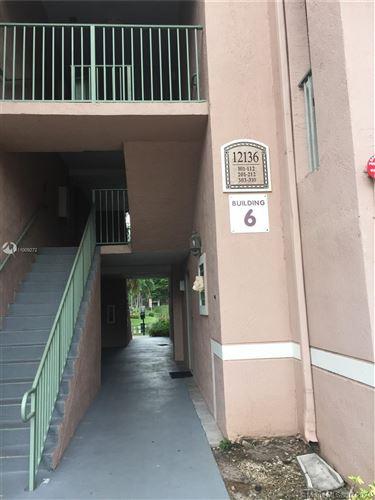 Photo of 12136 St Andrews Pl #112, Miramar, FL 33025 (MLS # A11009272)
