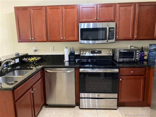 Photo of 11601 NW 89th St #220, Doral, FL 33178 (MLS # A10987273)