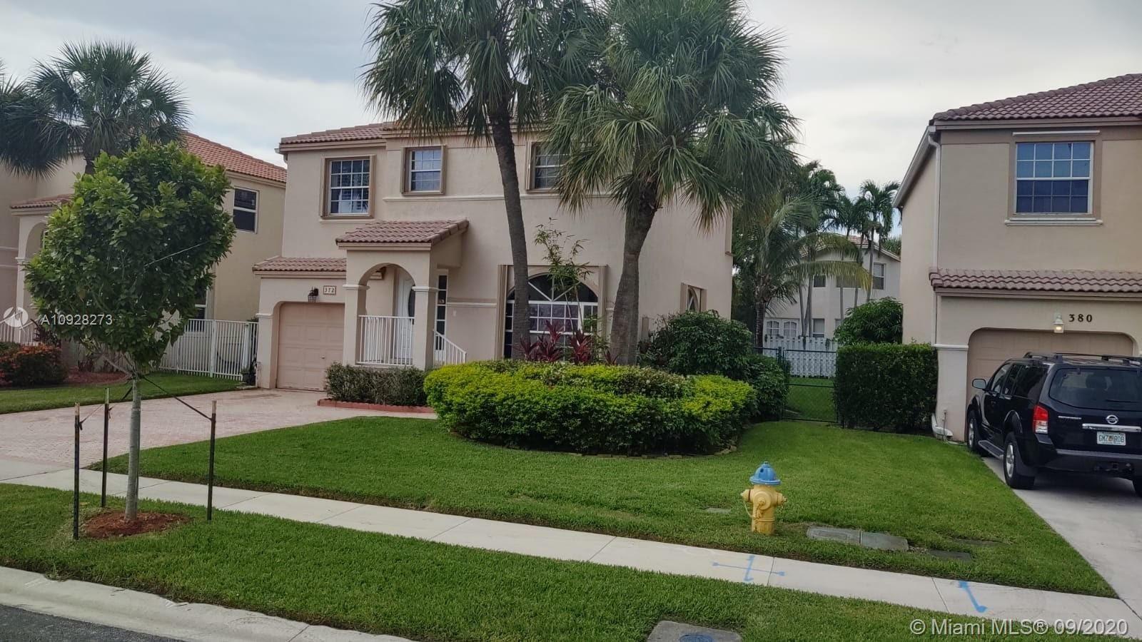Photo of 372 NW 153rd Ln, Pembroke Pines, FL 33028 (MLS # A10928273)