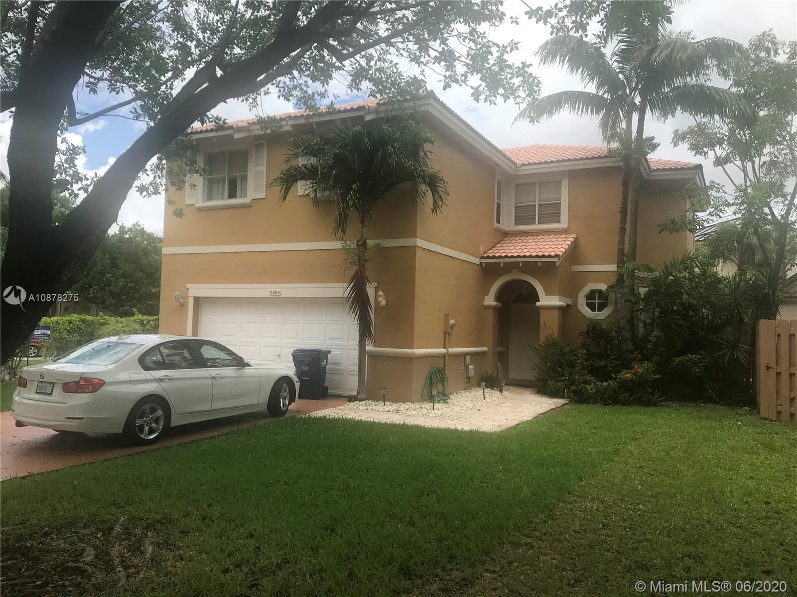 Photo of 11261 SW 156th Ct, Miami, FL 33196 (MLS # A10878275)