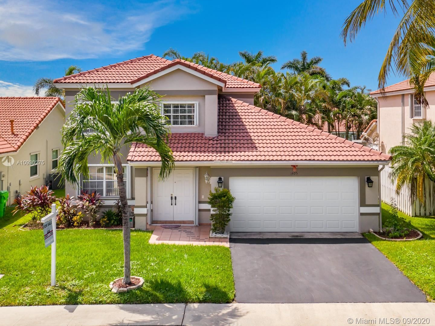 Photo of 1405 NW 129th Ter, Sunrise, FL 33323 (MLS # A10930275)