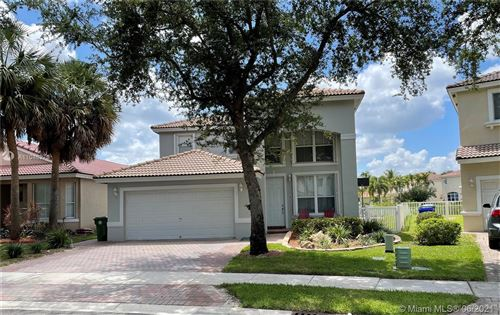 Photo of 1850 NW 78th Ave, Pembroke Pines, FL 33024 (MLS # A11048279)
