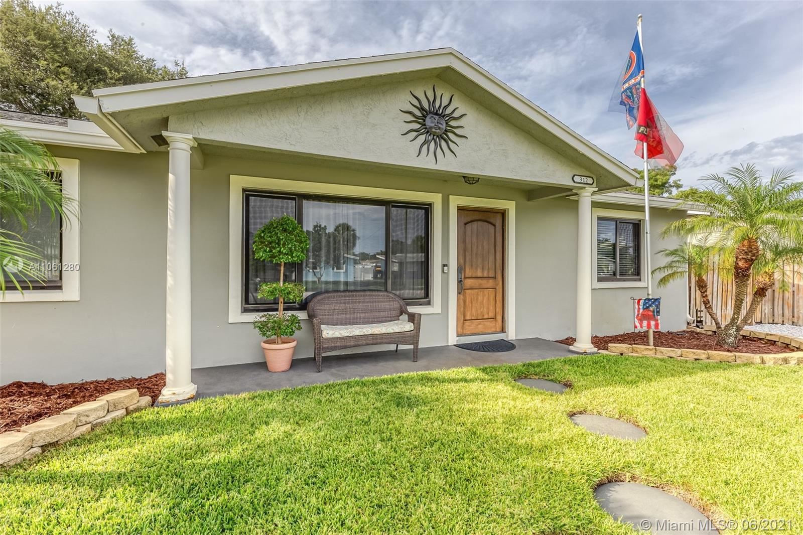 Photo of 312 Riverdale Rd, Palm Springs, FL 33461 (MLS # A11061280)