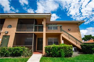 Photo of 10477 NW 7th St #104, Pembroke Pines, FL 33026 (MLS # A10740281)
