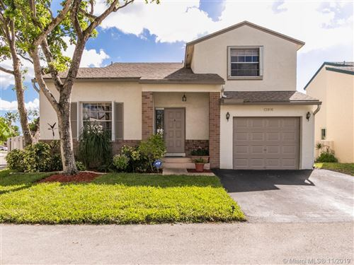 Photo of 13916 Langley Place, Davie, FL 33325 (MLS # A10772281)