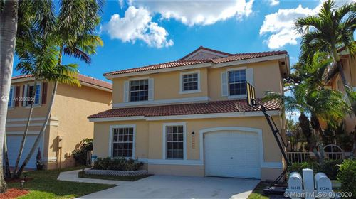 Photo of 11242 NW 46th Dr, Coral Springs, FL 33076 (MLS # A10800281)