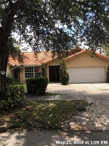 Photo of 8564 NW 165th Ter, Miami Lakes, FL 33016 (MLS # A10673282)