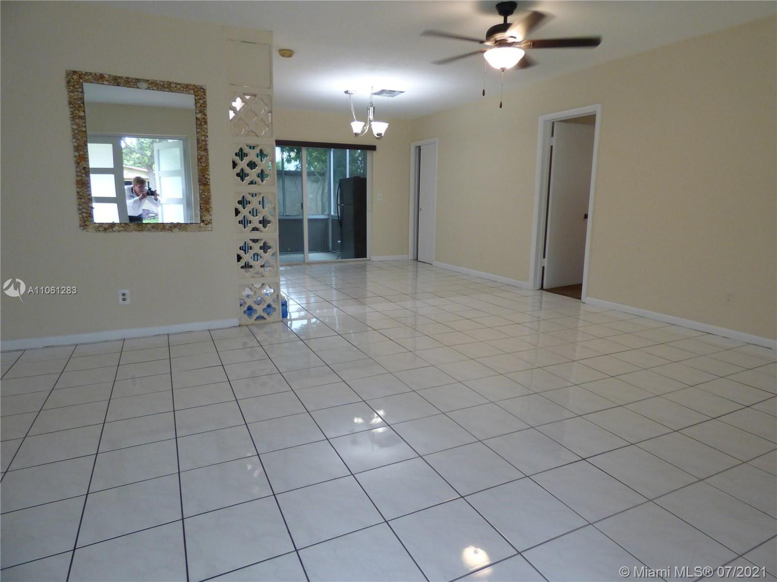 Photo of 830 NE 182nd St, North Miami Beach, FL 33162 (MLS # A11061283)