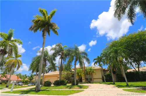 Photo of 10985 NW 2nd St, Plantation, FL 33324 (MLS # A10903284)