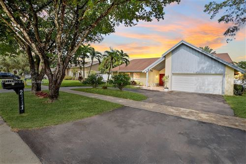 Photo of 2111 NW 103rd Ave, Pembroke Pines, FL 33026 (MLS # A11113284)
